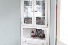 22 squeeze a corner cabinet into a corner of your dining space to maximize storage space here