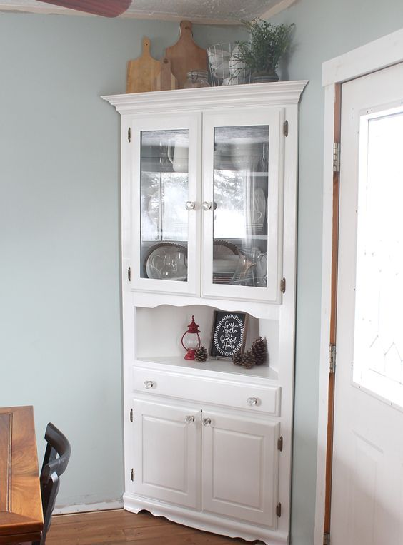 squeeze a corner cabinet into a corner of your dining space to maximize storage space here