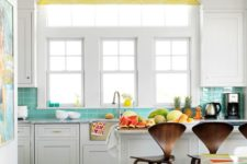 22 very eye-catchy dark stained and cutout stools that stand out in this bright and white kitchen