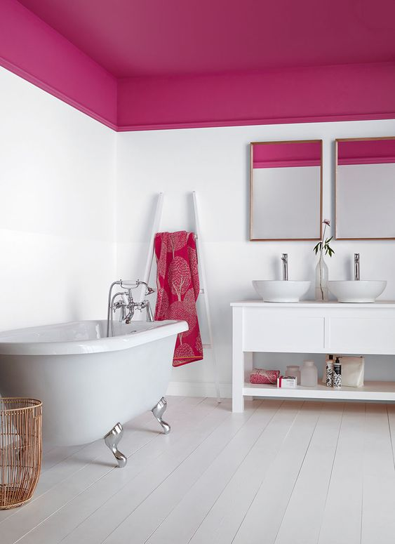 a contemporary bathroom that combines white and fuchsia and looks bright, cheery and bold