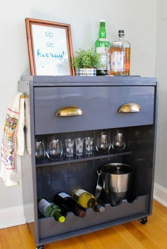 an IKEA Rast dresser turned into a stylish home bar on casters with a drawer and an open storage compartment