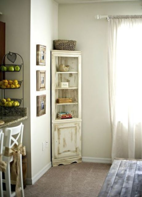 a distressed neutral corner cabinet is a chic idea for a living or dining room, you can DIY one