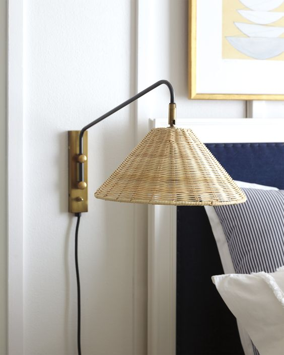 a stylish wall sconce with a wicker lampshade and brass touches will give your bedroom a coastal feel