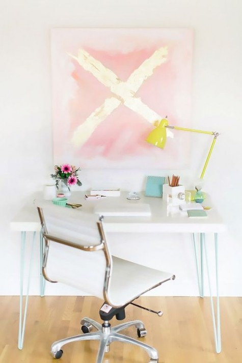 an IKEA Lack coffee table hack into a stylish desk with mint hairpin legs is a perfect fit for a contemporary space