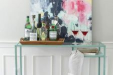 24 an IKEA Vittsjo desk hack into a stylish and contemporary home bar with an acrylic bottom for storage