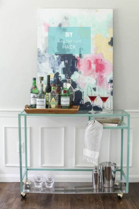 an IKEA Vittsjo desk hack into a stylish and contemporary home bar with an acrylic bottom for storage