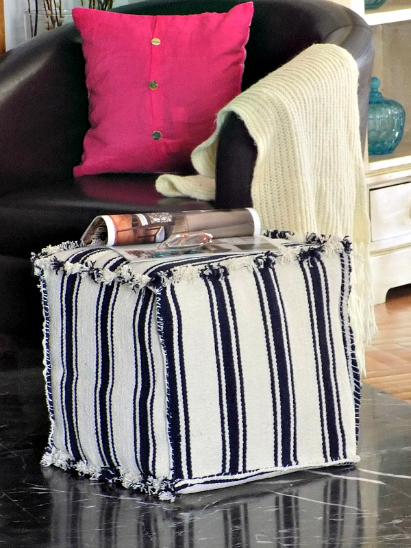 an ottoman or pouf made of striped IKEA rugs   make a cube of plywood and cover it with rugs