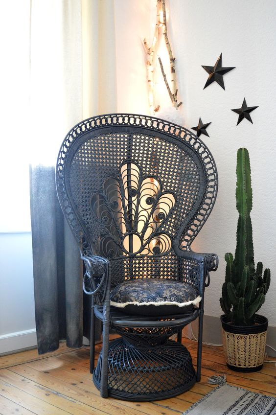 dark painted peacock chairs look very unusual as they are traditionally neutral, here a navy peacock chair for a moody feel