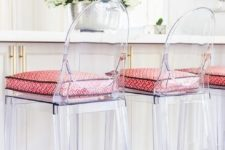 24 ghost counter stools with bright printed cushions on the seats are trendy and modern to refresh a vintage kitchen island