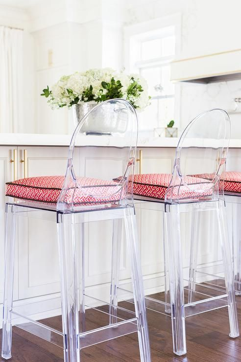 ghost counter stools with bright printed cushions on the seats are trendy and modern to refresh a vintage kitchen island