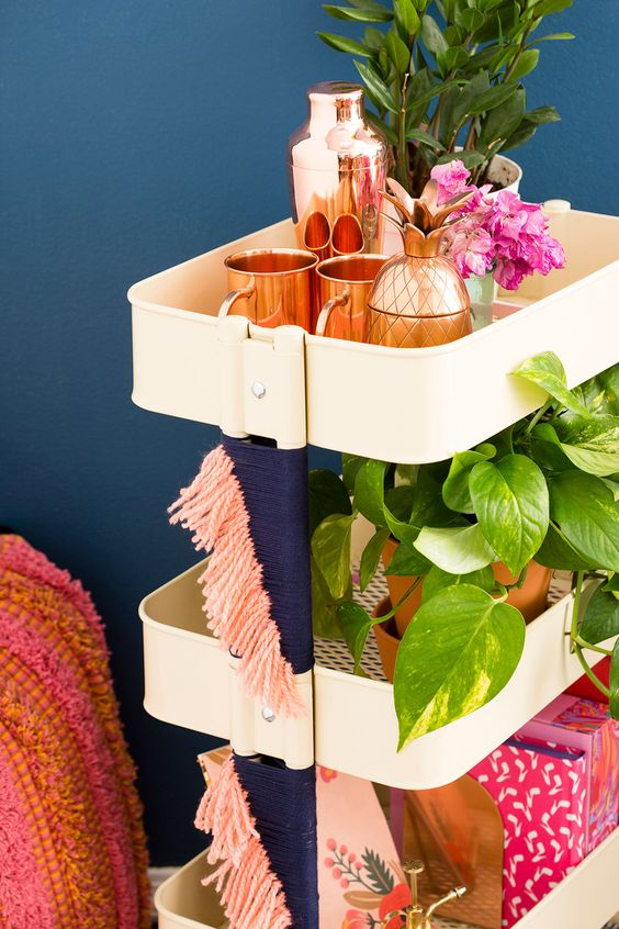 IKEA Raskog cart refreshed with navy and pink fringe on its sides is a great idea for a boho space