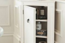 25 a stylish tiny corner cabinet like this one will give you more storage space in a bathroom