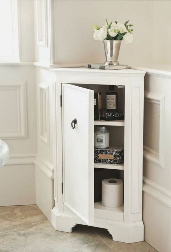 a stylish tiny corner cabinet like this one will give you more storage space in a bathroom