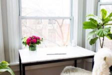 25 an IKEA Tarendo dining table hacked with marble contact paper into a simple desk