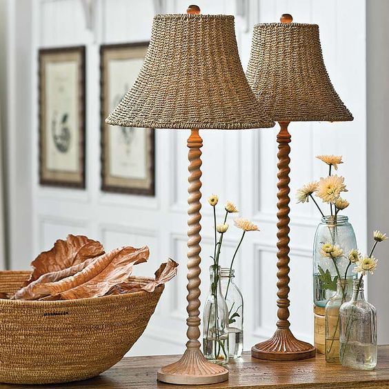 vintage-inspired table lamps with carved wooden legs and wicker lampshades will bring that vintage beach cottage esthetics