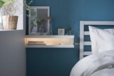 26 IKEA Mosslanda ledges turned into a floating nightstand with lights, which is ideal for a small bedroom