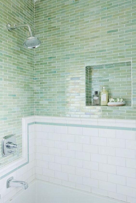 green blue skinny tiles clad horizontally paired with white subway tiles make up a stylish look