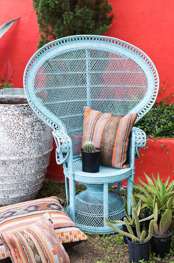 refresh your peacock chair with blue paint and a folksy pillow to make your boho nook more colorful