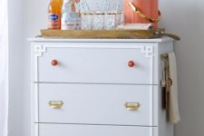 26 this IKEA Tarva dresser is adapted into a functional moveable entertaining station or bar with cool knobs and handles