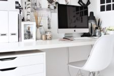 a Scandinavian home office done in mostly white, with a black noteboard and some more touches for an accent