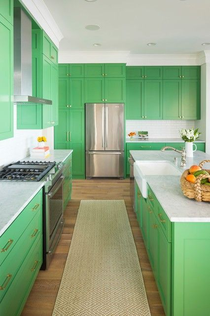 a bright green kitchen with white countertops and neutral handles is a very bold idea