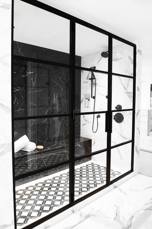 a gorgeous black and white bathroom with a shower space
