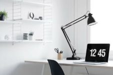 a simple Nordic black and white home office with a white desk, shelving unit, a black chair and a storage fabric basket