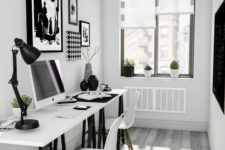 a small Scandinavian home office with a two black and white trestle desks, white chairs and black and white artworks