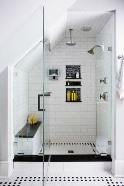 a stylish monochromatic shower with a built-in bench with a black seat that matches the floor and adds drama
