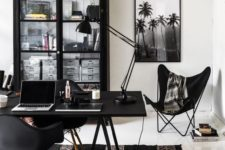 a whimsical black and white home office with black furniture, white as a blank canvas and black and white art