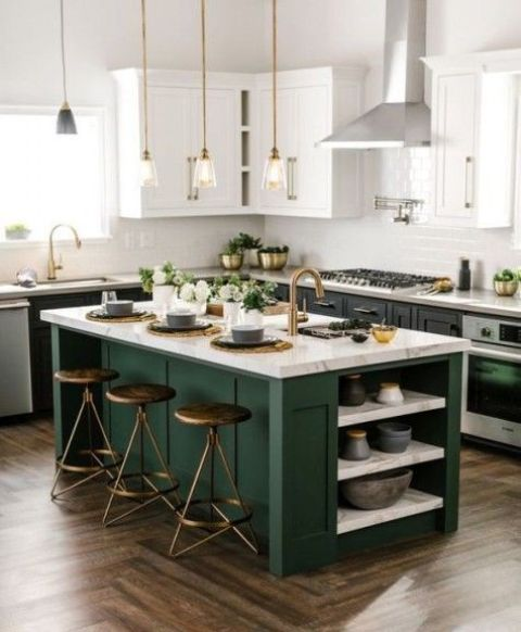 black cabinets with white countertops and a forest green kitchen island with a neutral stone countertop, too