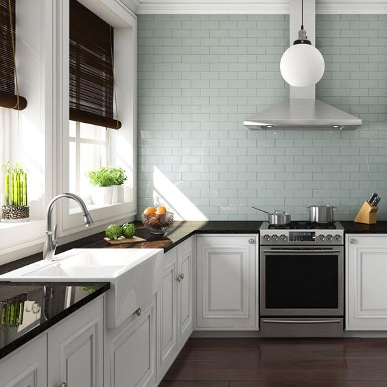 elegant white cabinets are perfectly completed with dark stained countertops and dark shades that match