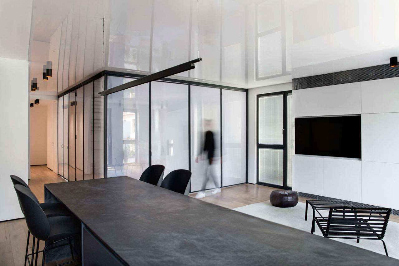 This chic minimalist apartment features a unique idea   a bedroom clad with a plastic box, which is a cool idea
