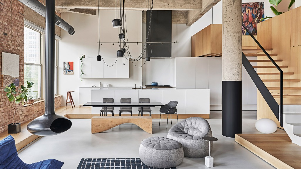 This gorgeous industrial meets minimalist loft features structural details and cool furniture arrangement to get maximum of the apartment