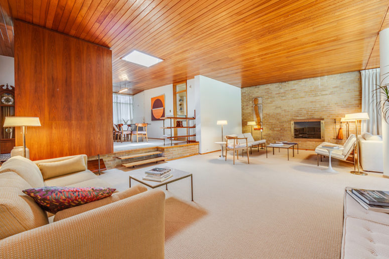 This gorgeous mid century modern home in Toronto is done with amazing honey toned wood, which gives it a character