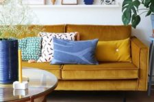 02 a bright living room done in mustard and shades of blue and navy is a gorgeously bold idea