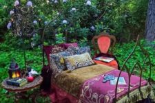 02 a forged boho daybed placed right in the garden to create a relaxation oasis outdoors