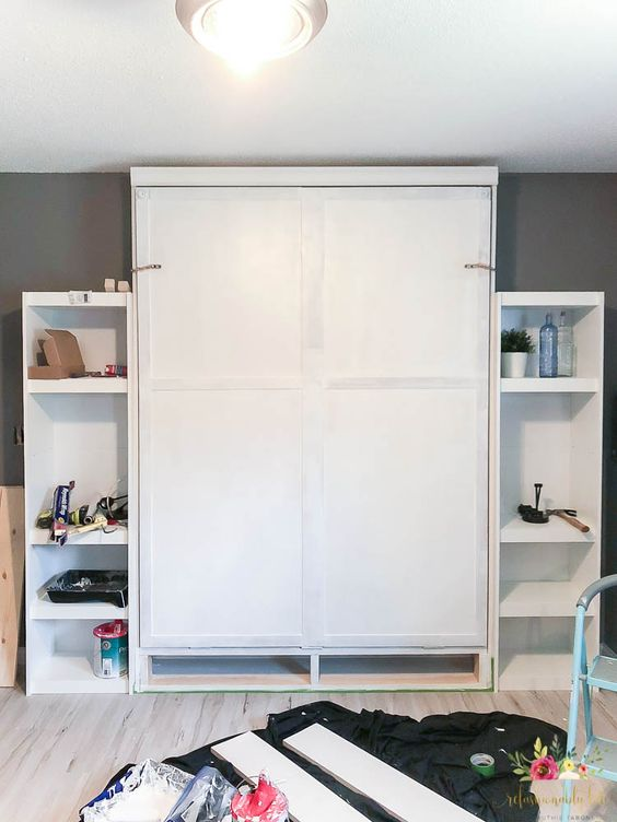 here's how a Murphy bed looks when not in use, just add shelves on each side to make the piece more functional
