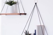 02 simple and elegant hanging shelves with several threads attached to the rings on the wall for a boho feel