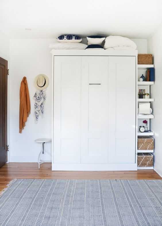a hidden Murphy bed looks sleek, doesn't clutter the space and you can have a whole room for yourself