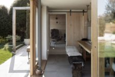 04 The inside of the cottage features natural and reclaimed materials including much wood
