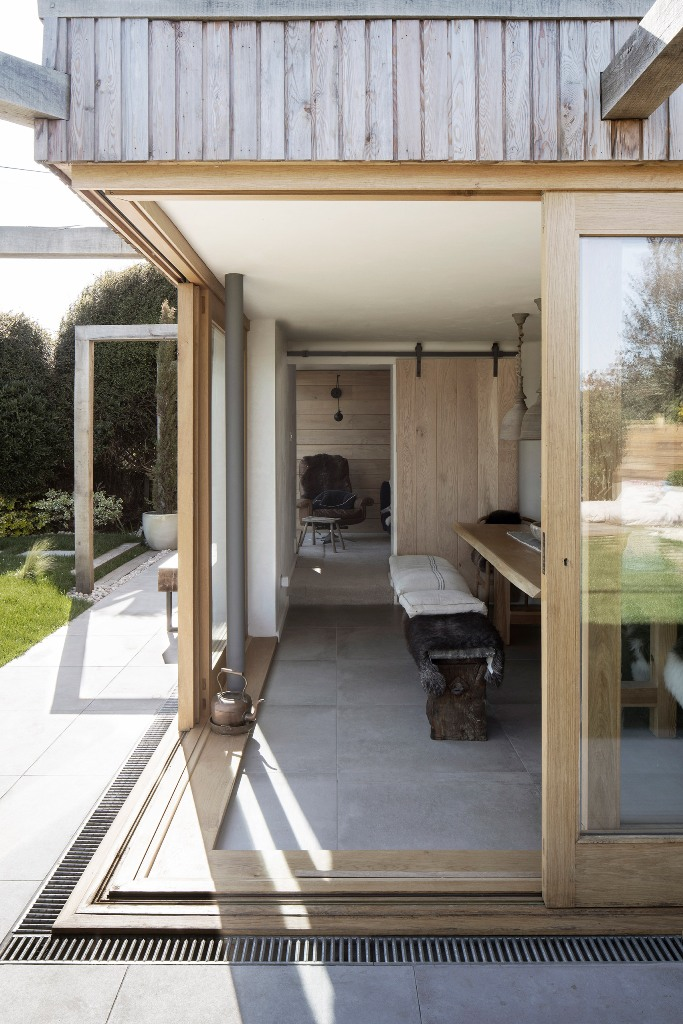 The inside of the cottage features natural and reclaimed materials including much wood