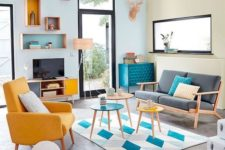 04 a bright retro living room in bold blue and yellow with a touch of geometric pattern