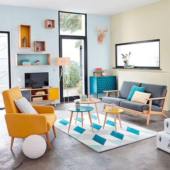 a bright retro living room in bold blue and yellow with a touch of geometric pattern