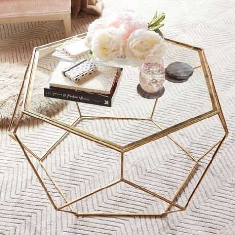 a geometric gold coffee table with a glass top looks catchy, glam and super cute