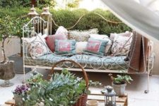 04 a super elegant and French chic forged daybed with lots of pillows on casters is a great piece for a romantic area