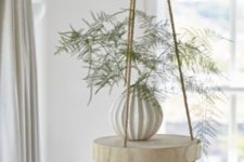 05 a cool and easy hanging shelf of a thick wood slice and ropes can be easily DIYed and will add a dreamy feel to the space