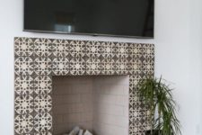 05 chic patterned earthy tone tiles and blush painted brick inside soften the living room decor and add chic