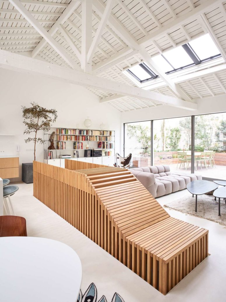 Skylights and an entrance to the terrace bring much natural light to the space