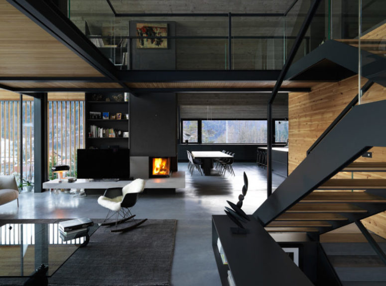 The spaces seamlessly flow into each other, a built-in fireplace brings coziness to all of them
